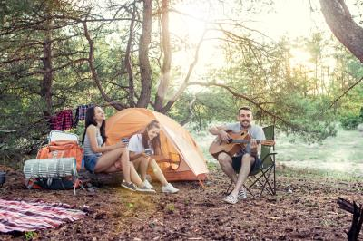 party-camping-men-women-group-forest-relaxing-singing-song-against-green-grass